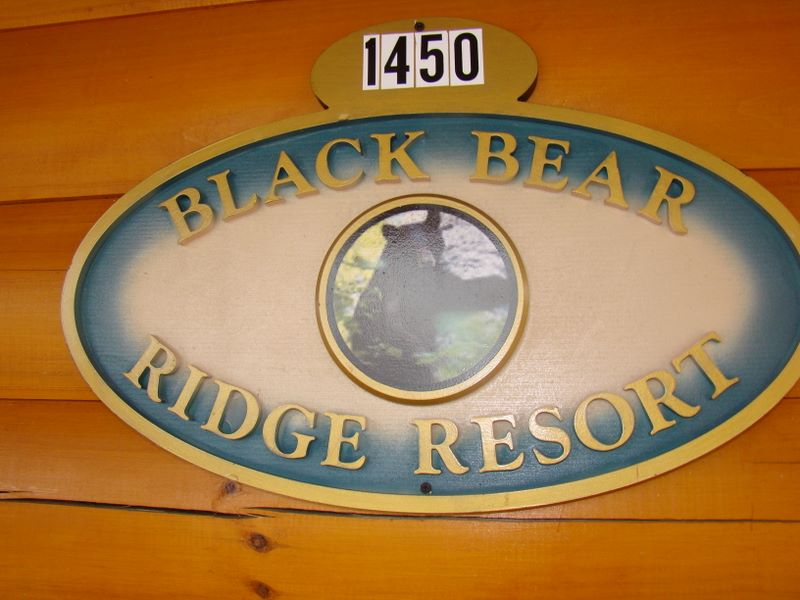Sign on the front of a cabin in Black Bear Ridge denoting the address of the property located in Pigeon Forge TN