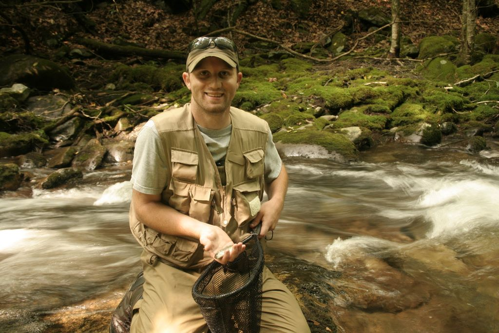 Jay Fradd catching a small rainbow trout on Bradley Fork in the Smoky Mountains - Fly fishing in the Smokies