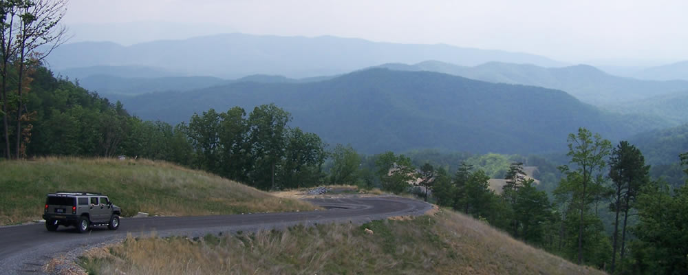 Views From The Preserve At English Mountain - Luxury Smoky Mountain Community offering spectacular views, gated community, community clubhouse, and two helipads