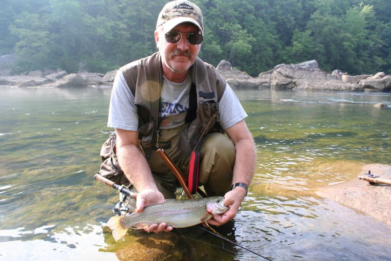 John Hudson Smith IV with a rainbow trout he caught on the Gauley River in West Virginia
