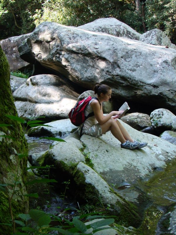 Brooke Fradd relaxing on a boulder on the Little River - Smoky Mountains National Park