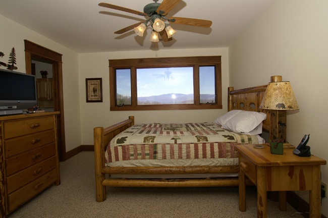 A Master Bedroom in a cabin with a great mountain view