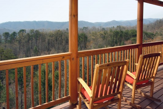 Pet Friendly cabin just minutes to Pigeon Forge with great mountain views! Located in the exclusive Sherwood Forest Resort with a community pool! The cabin sleeps 8 with flat screen TV's and high end decorations and furnishings!